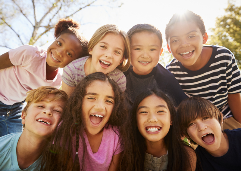 Multi-ethnic group of schoolchildren on school trip